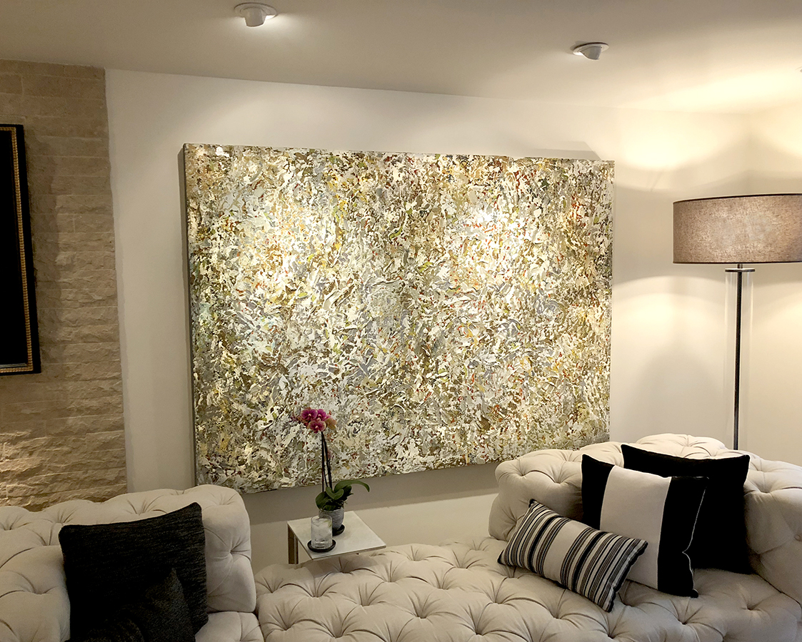 abstract painting by chase langford hanging in a home